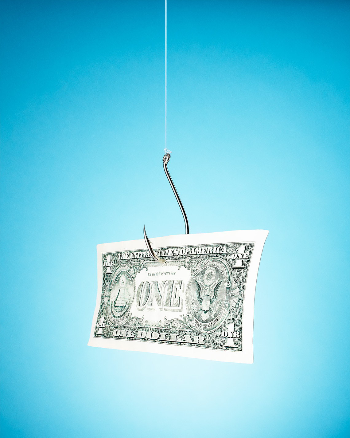 A dollar bill trapped to a fishhook on a blue background