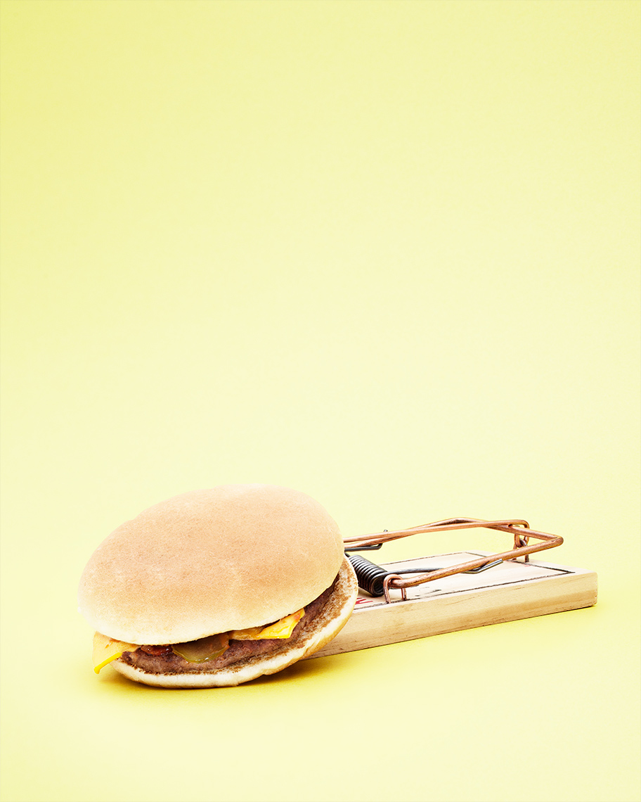A cheeseburger in a mousetrap