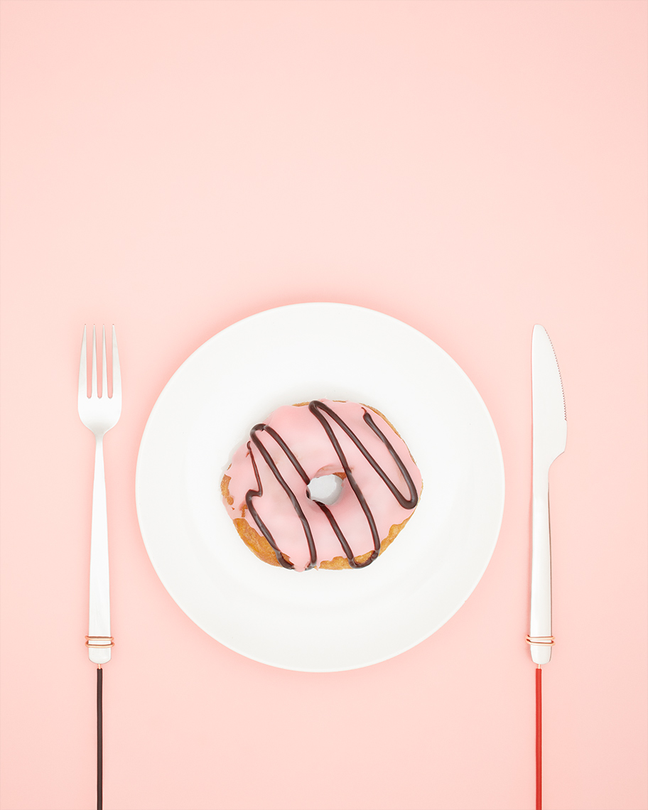 A potential electrified donut on a pink background