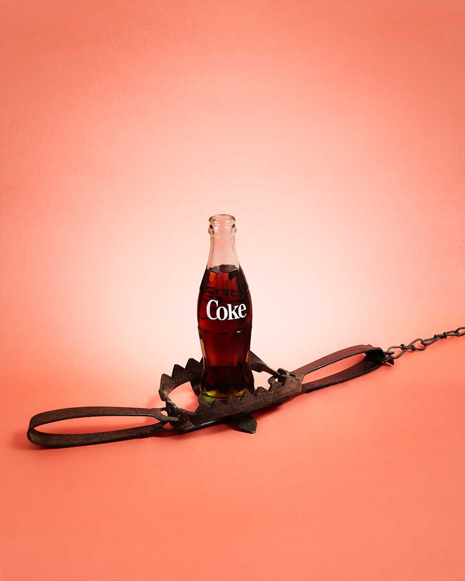 A coke bottle in an animal trap