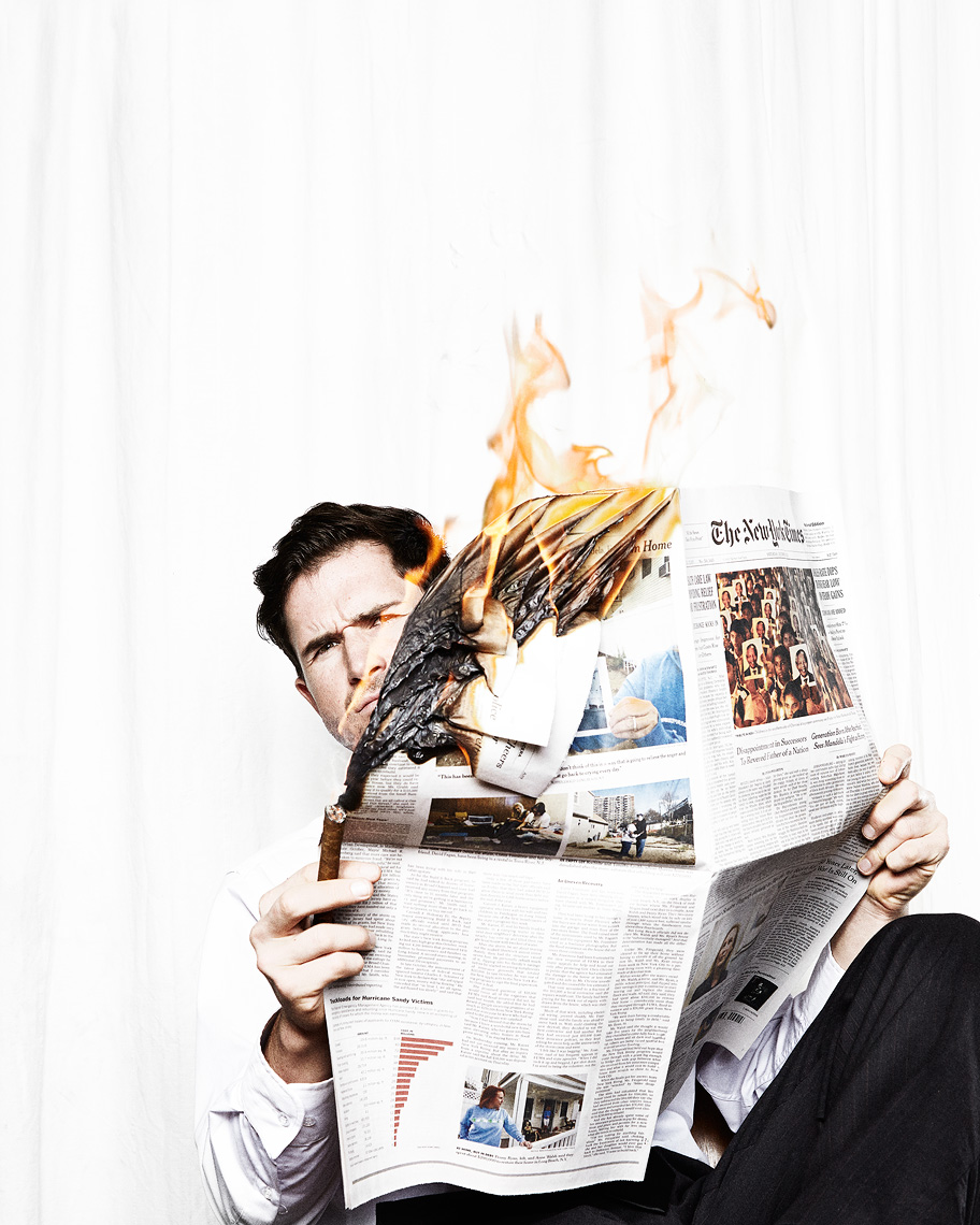 Guy reading a burning newspaper