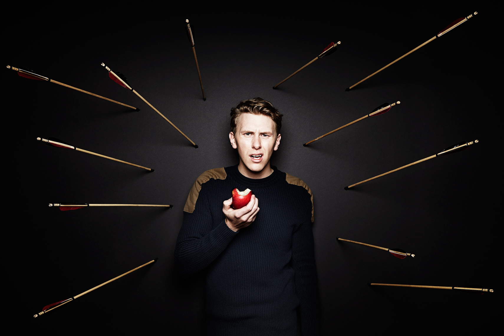 Guy eating an apple surrounded by arrows