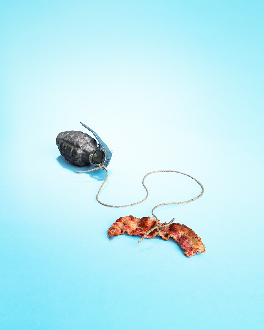A piece of bacon tied to a hand grenade